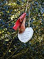 City of London Cemetery discarded grave tribute in trees.jpg