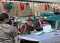 Col. Can Bolat and Col. Qussimi, Assistant to Minister Jawhari sign documents (4699289657).jpg