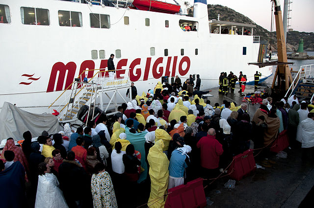 Is Capt. Schettino hiding under a blanket in this crowd of survivors?