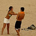 Couple playing at the beach (8297526208).jpg