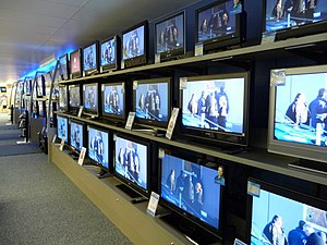 Television - Flat-screen televisions for sale at a consumer electronics store in 2008.