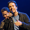 Craig Kielburger at We Day Waterloo 2011 with his brother, Marc Kielburger, in the background.jpg