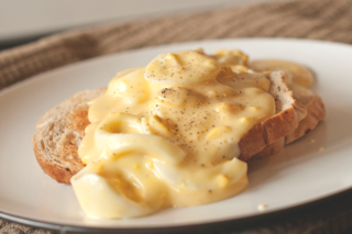 Creamed eggs on toast American breakfast dish consisting of cream sauce and hard-boiled eggs on toast or biscuits