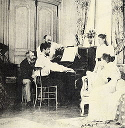Debussy at the piano, behind him is the composer Ernest Chausson, 1893