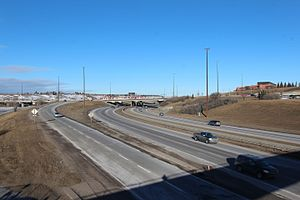 Deerfoot Trail - Deerfoot Trail curving under Memorial Drive and the Northeast Line of the CTrain. The interchange was constructed as part of the second Deerfoot segment that opened in 1975, and the CTrain bridges were constructed in 2000.
