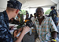 Defense.gov News Photo 110413-N-NY820-033 - U.S. Navy Petty Officer Ryan Wyatt left examines a patient on the first day of a medical screening clinic in Kingston Jamaica during Continuing.jpg