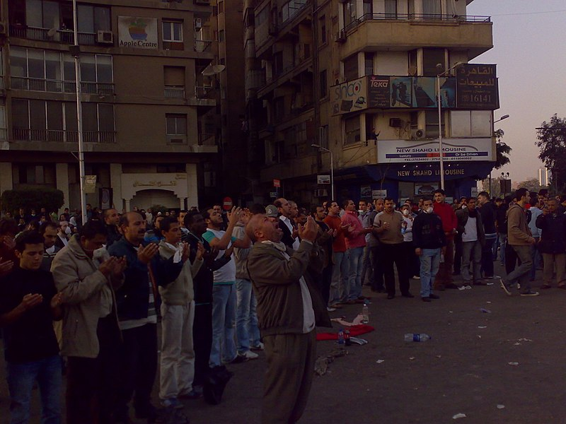 File:Demonstrators Prayng in Galae Square, Cairo.jpg