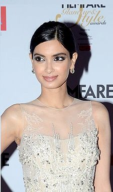 Diana Penty smiling at the camera