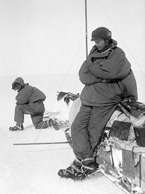 Far Eastern Party - Mawson rests on one of the sledges at Aladdin's Cave during the outward journey