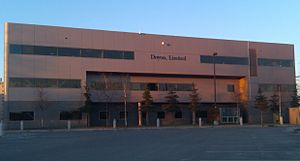 Doyon, Limited - The front (top, facing southerly) and back (above, facing northerly) sides of Doyon's headquarters building in downtown Fairbanks