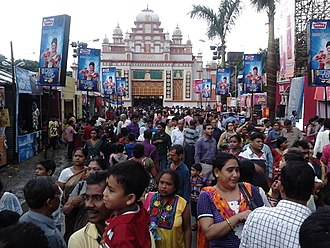 Bagbazar - Durga puja pandal with spectators. Oct 2013.