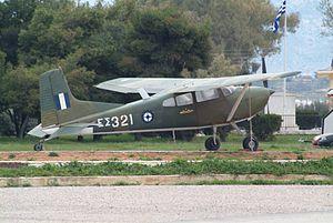ES 321 Cessna U-17B Bird Dog preserved as a gate guard at Megara.jpg