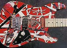 Red-and-white, solid-body electric guitar