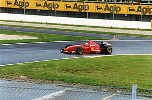 Eddie Irvine - Irvine driving for Ferrari at the 1996 San Marino Grand Prix.