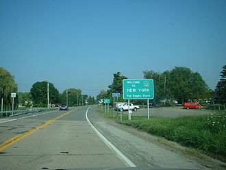 New York State Route 5 - The western terminus of NY 5 at the Pennsylvania state line, from where the first reference and reassurance markers on NY 5 eastbound are visible.