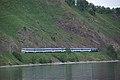 Excursion train of Circum-Baikal railway- ED9MK-0029 EMU under TEM2-6550 (32123488302).jpg