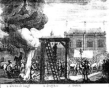A gallows is in the centre of the image, to its left a large bonfire; a crowd watch.