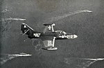 F9F-2 Panther of VF-821 in flight over Task Force 77 off Korea, circa 1952.jpg