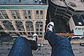 Feet dangling from a building (Unsplash).jpg