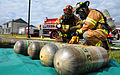 Fire fighters exercise real world tactics 130607-F-IW726-201.jpg