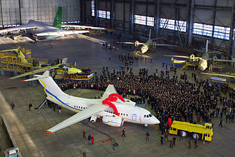 Antonov Serial Production Plant - Rollout of the first serially-produced An-148 at AVIANT's gigantic hangar in Kiev, 2009. An An-124 under maintenance seen in the far corner of the hangar.