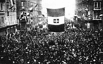 Fascism and ideology - Residents of Fiume cheer the arrival of Gabriele D'Annunzio and his blackshirt-wearing nationalist raiders, as D'Annunzio and Fascist Alceste De Ambris developed the quasi-fascist Italian Regency of Carnaro (a city-state in Fiume) from 1919 to 1920 and whose actions by D'Annunzio in Fiume inspired the Italian Fascist movement