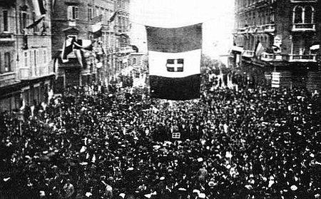 Residents of Fiume cheer the arrival of Gabriele d'Annunzio and his blackshirt-wearing nationalist raiders, as D'Annunzio and Fascist Alceste De Ambris developed the quasi-fascist Italian Regency of Carnaro (a city-state in Fiume) from 1919 to 1920 and whose actions by D'Annunzio in Fiume inspired the Italian Fascist movement. Fiume cheering D'Annunzio.jpg