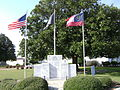 Flagpoles SE corner of Mitchell County Courthouse.JPG