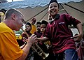 Flickr - Official U.S. Navy Imagery - A member of the U.S. 7th Fleet Brass Band, encourages a child to assist him in playing the trumpet during a community service project..jpg
