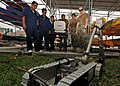 """Flickr - Official U.S. Navy Imagery - An Explosive Ordnance Disposal Technician assist's while a member of the Royal Malaysian navy uses the """"Pacbot"""". (1).jpg"""