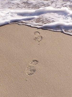Footprints in sand. Marinha Grande, Portugal.