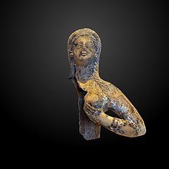 Fragment of a statuette of a woman