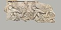 Furniture plaque carved in relief with two falcon-headed sphinxes trampling captives MET DP110680.jpg