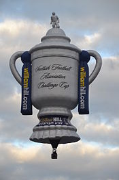 A hot air balloon shaped like the Scottish Cup trophy.