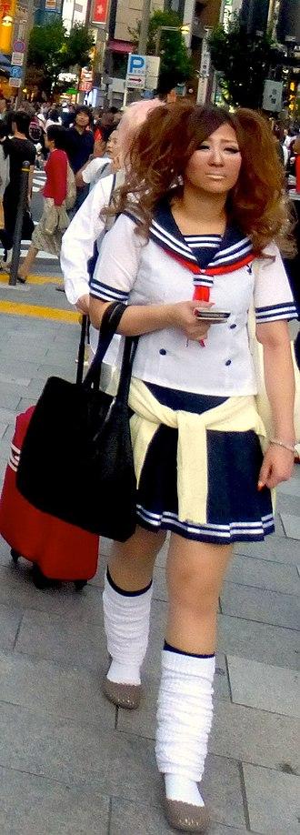 Ganguro - Ganguro style and a school uniform in Shinjuku, September 2015