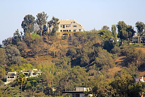 Garbutt House - The house, atop the hill, as viewed from a distance