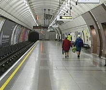 Photo looking along a platform with a cylindrical roof.
