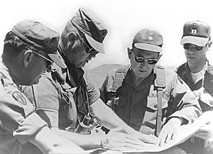 Norman Schwarzkopf Jr. - Schwarzkopf, then a colonel, consults with other officers during a training mission in California in 1977.