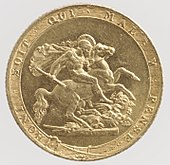 A gold coin showing as its central element a naked man on a horse attacking a dragon using a broken spear
