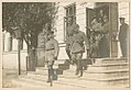 German officers exit a building (9365987903).jpg