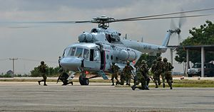 Ghana Air Force - A Ghanaian special forces team board a Mi-17 helicopter
