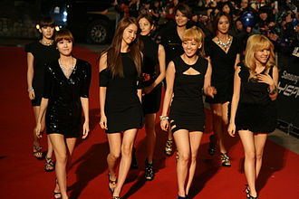 Girls' Generation - Girls' Generation attending the 2010 Golden Disk Awards