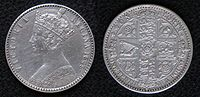 Both sides of a silver coin, with a crowned woman on one side and shields on the other