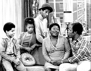John Amos - On Good Times (1974), L-R: Ralph Carter, BernNadette Stanis, Jimmie Walker, Esther Rolle, and John Amos.