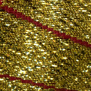 Cloth of gold rich Medieval fabric woven with gold thread or a combination of gold and silk