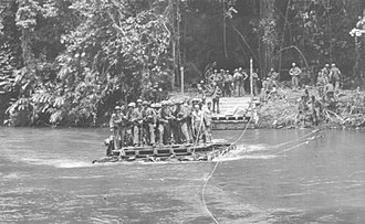 Matanikau Offensive - U.S. Marines cross the Matanikau River on a raft ferry in November 1942