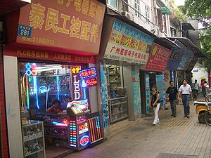 Guangdong - Shops in one of the streets of Guangzhou specialize in selling various electronic components, supplying the needs of local consumer electronics manufacturers. The shop in front is in the LED business.