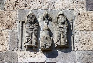 Haghartsin Monastery - Low-relief depiction commemorating the patronage of the Zakaryan brothers, on the upper east exterior wall of S. Astvatatsin Church.