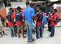 Haitian students in red shirts are teaching classes on sanitation and HIV prevention to residents of Port-au-Prince, Haiti, March 18, 2010 100318-N-HX866-004.jpg