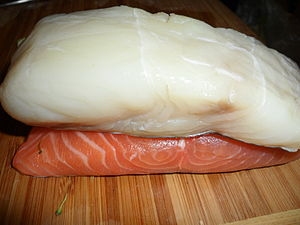 Oily fish - Oily fish fillet (salmon – bottom) contrasted with a white fish fillet (halibut – top)